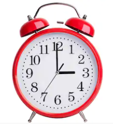 What is the time shown on the alarm clock?